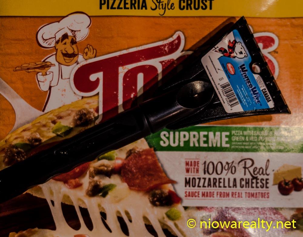 An Ice Scraper and a Pizza Box